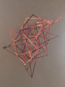 Mette Ussing, På væggen ca. 100x75x75 cm. Fyrværkeripinde